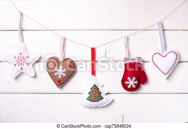 Christmas decorations with stars and tree on white wooden background. Xmas and Happy New Year composition. Horizontal. - csp75848534