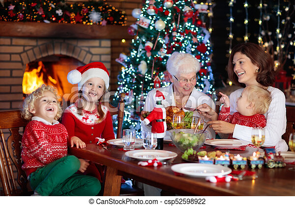 Christmas dinner. family with kids at xmas tree. Family with ...