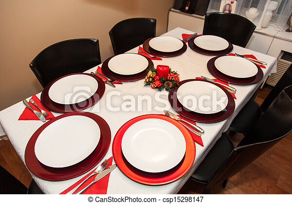 simple decorated christmas dinner table for eight people