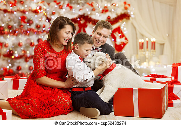 Christmas Family give Dog Present Gift, Happy Father Mother Child and  Animal celebrating New Year