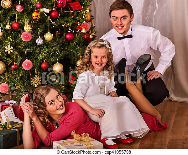 Christmas Family Portraits.Christmas Family Portrait With Children Dressing Xmas Tree