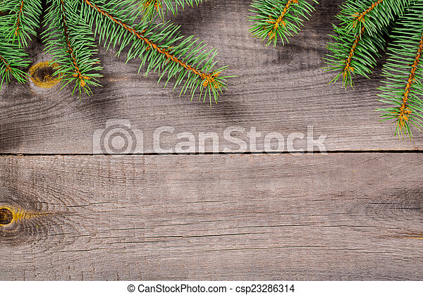 Christmas fir tree on a wooden background - csp23286314