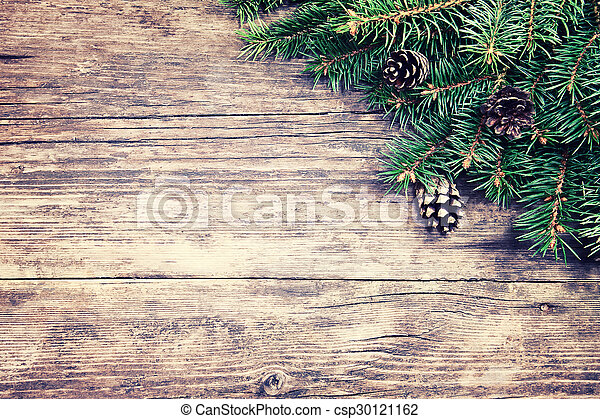 Christmas fir tree on a wooden background - csp30121162