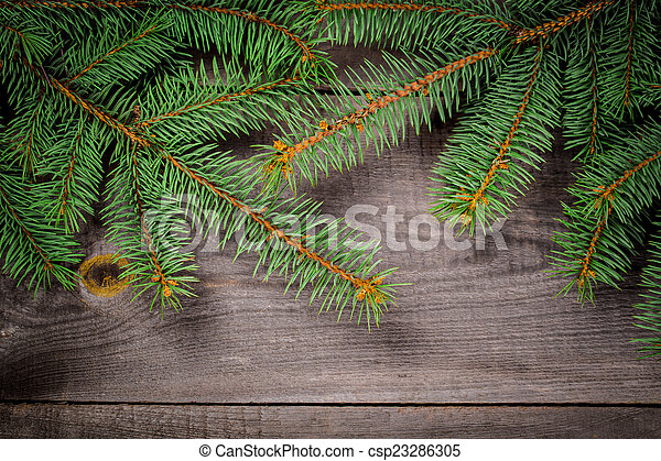 Christmas fir tree on a wooden background - csp23286305