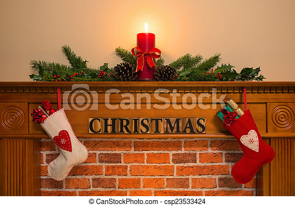 Christmas Fireplace With Stockings And Candle Mantelpiece With Red Candle And Fresh Garland Made From Holly Two Stockings