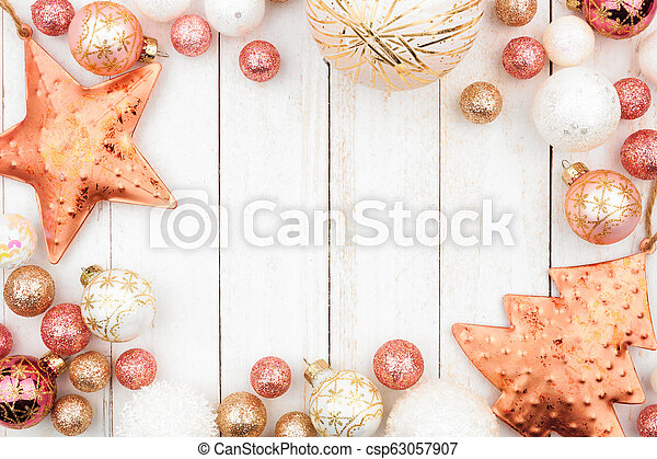 Christmas Frame Of Rose Gold White And Gold Ornaments On White Wood