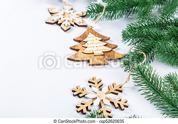 Christmas Frame.Christmas Frame With The Branches Of The Christmas Tree And Wooden Decorations On White Background Simple Christmas Composition With Free Space