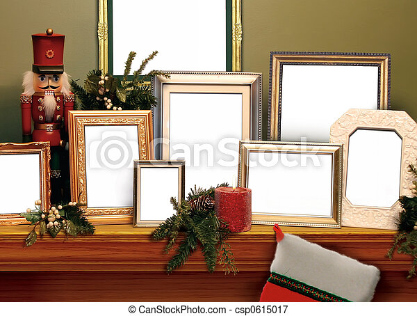 Christmas frames. A mantel or shelf, decorated for the holidays ...