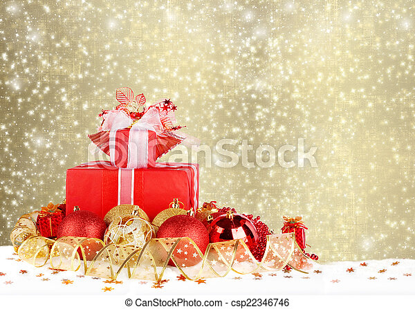 Christmas gifts and balls with gold ribbon on a beautiful abstra - csp22346746