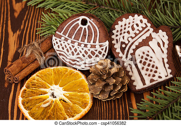 Christmas Gingerbread Cookies Cinnamon And Orange Slice On Wooden Background