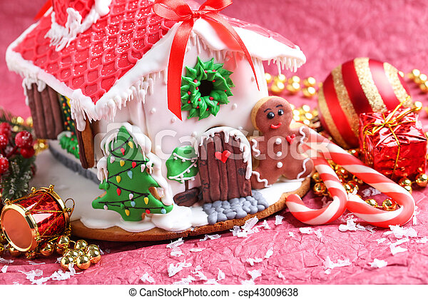 Christmas Gingerbread House Background.Christmas Gingerbread House On Red Background