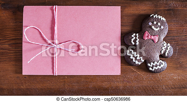 Christmas gingerbread man cookie and envelope - csp50636986