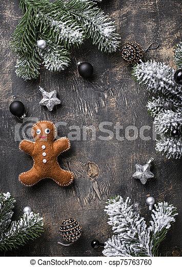 Christmas gingerbread man made by felt - csp75763760