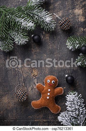 Christmas gingerbread man made by felt - csp76213361