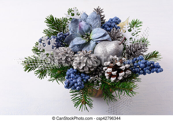 Christmas Greenery.Christmas Greenery With Silver Glitter Decor And Blue Silk Poinsettias