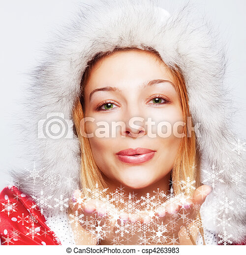 Christmas - happy woman blowing snow flakes - csp4263983