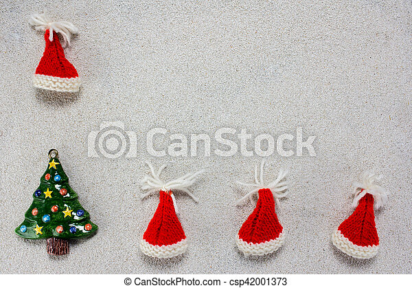 db6ab3895ed93 Christmas-hats and snow. A colorful christmas tree and red christmas ...