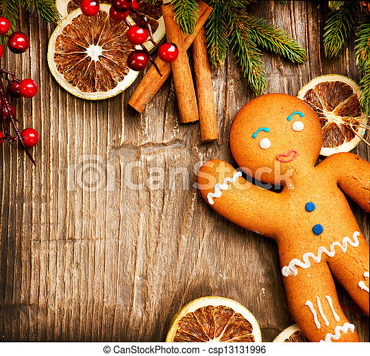 Christmas Holiday Background. Gingerbread Man over Wood  - csp13131996