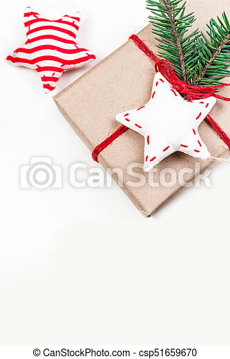 Christmas holidays background with festive decorations and gift boxes on white wooden board with copy space for your text - csp51659670