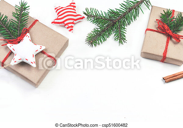 Christmas holidays background with festive decorations and gift boxes on white wooden board with copy space for your text - csp51600482