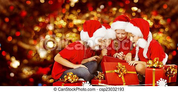 christmas kids opening present gift box happy children csp23032193