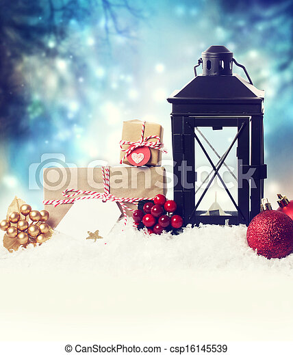 Christmas lantern with ornaments in the snow - csp16145539