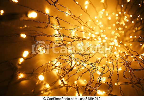 christmas lights garland blurred led bulb light background yellow lighting bokeh csp51894210