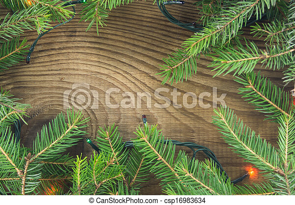 Christmas lights on wooden background - csp16983634