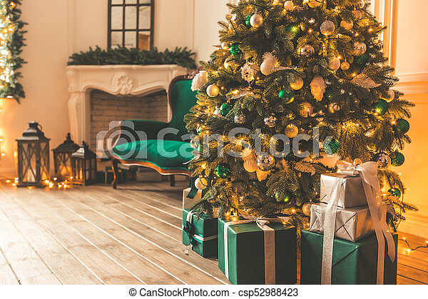 Christmas Living Room With A Fireplace Sofa Christmas Tree And Gifts Beautiful New Year Decorated Classic Home Interior Winter Background