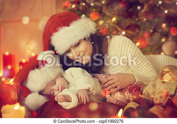Mother Christmas.Christmas Newborn Baby And Mother New Born Kid Sleep With Mom In Santa Hat Child Sleeping Under Xmas Tree