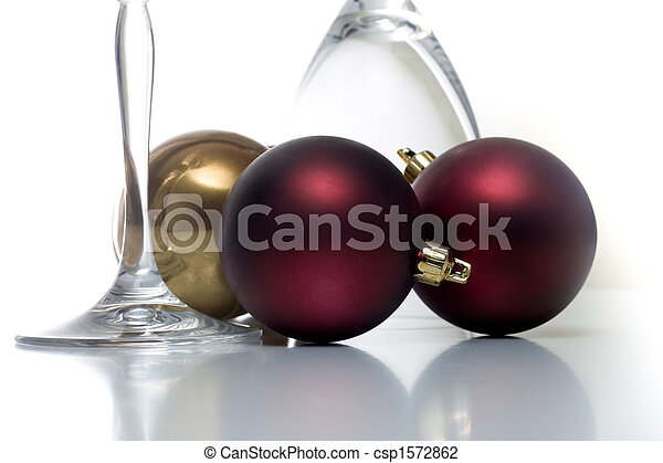 christmas ornament and champagne glasses on white csp1572862