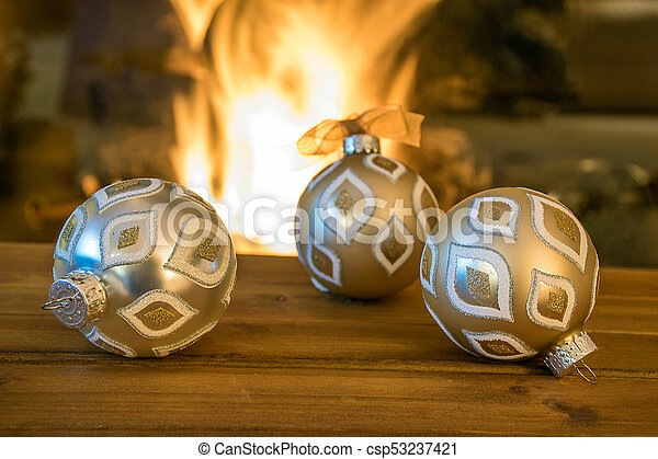 Christmas ornament by fireplace - csp53237421