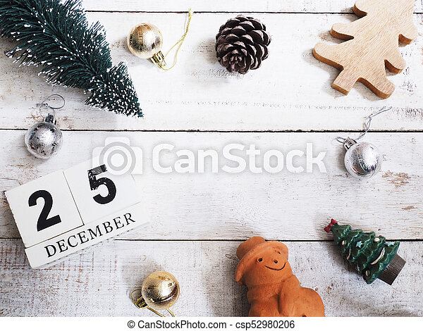 Christmas ornament decoration on wooden grunge background - csp52980206