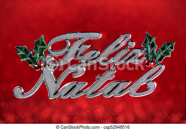 """Christmas ornament wrote """"Merry Christmas"""" greeting in portuguese isolated on red defocused background - csp52948516"""
