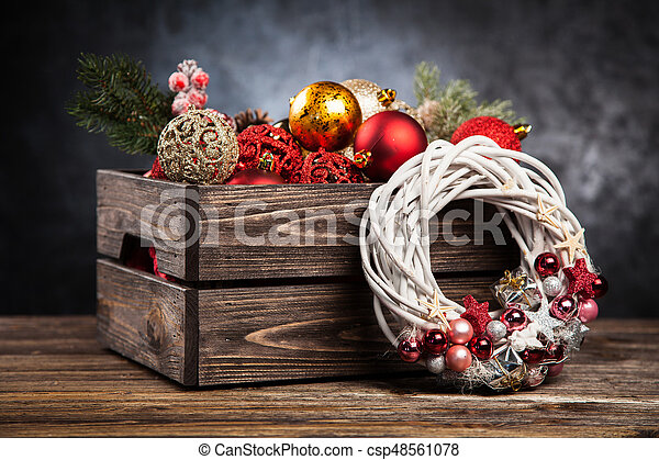 Christmas ornaments in a wooden crate - csp48561078