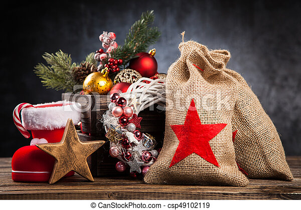 Christmas ornaments in a wooden crate - csp49102119
