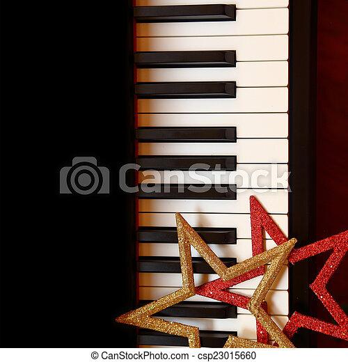 Christmas ornaments on piano keys - csp23015660