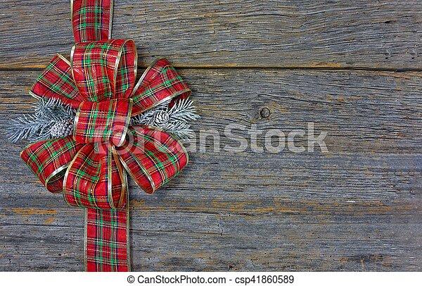 Christmas plaid bow on wood - csp41860589
