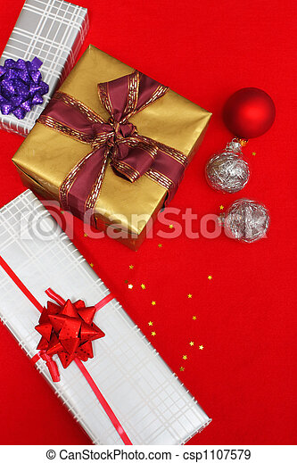 christmas presents on red - csp1107579