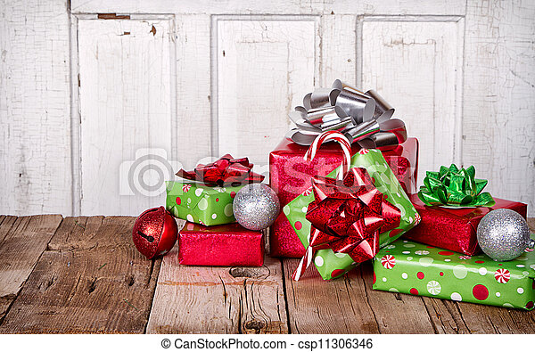 Christmas Presents on Wooden Background - csp11306346