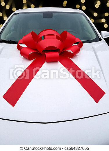 Christmas red bow on car - csp64327655