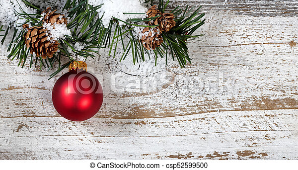 Christmas Red Ornament Hanging From Snowy Rough Fir Tree Branch