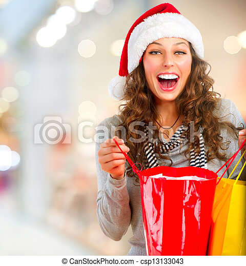 Christmas Shopping. Happy Woman with Bags in Mall. Sales - csp13133043