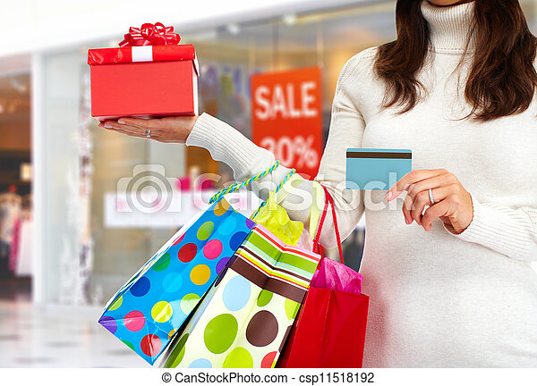 Christmas shopping woman with gift. - csp11518192