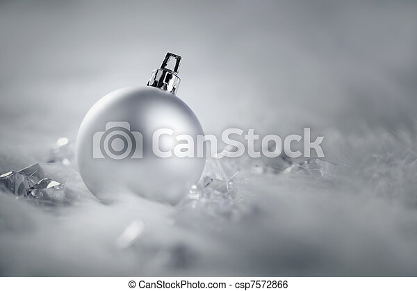christmas silver bauble on fur snow and ice - csp7572866