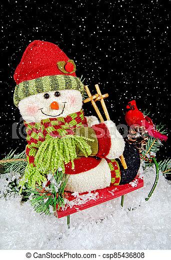 Christmas snowman on sled - csp85436808