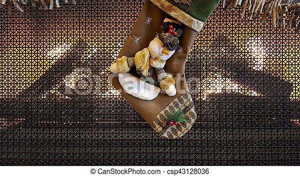 Christmas snowman stocking on fireplace - csp43128036
