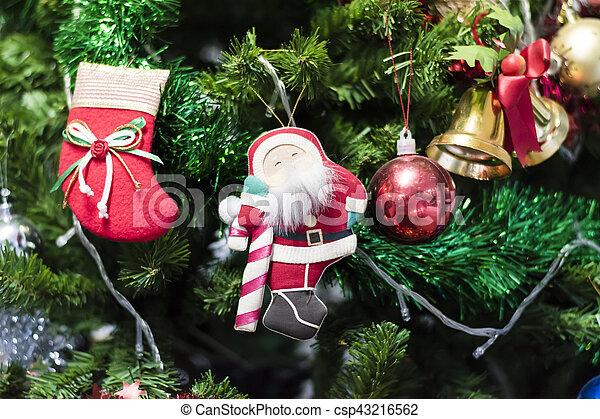 Christmas socks hanging on a Chrismas tree. - csp43216562