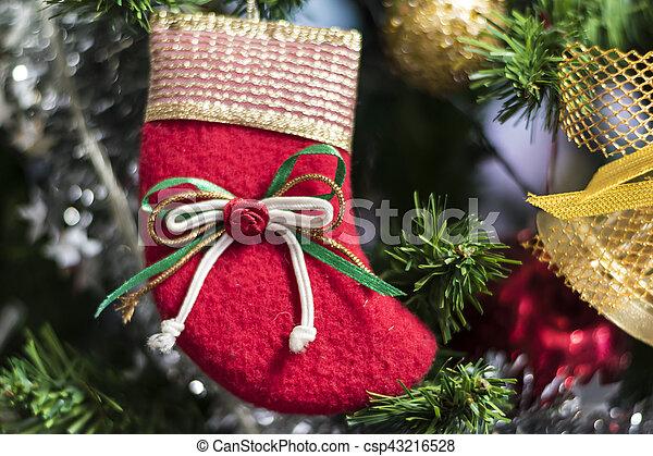 Christmas socks hanging on a Chrismas tree. - csp43216528
