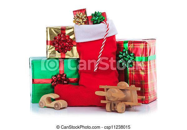 Christmas stocking with gifts wrapped presents and toys photo of a christmas stocking with gifts wrapped presents and toys negle Images